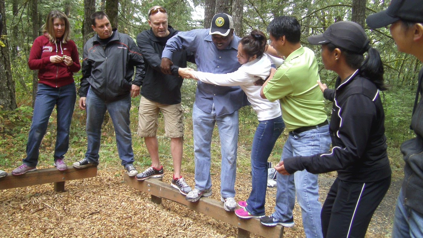 Tree To Tree Arial Adventure Park's Team building program utilizes various obstacles located on the ground that are designed to challenge the group on a physical, intellectual and, sometimes, emotional level. Each element and activity is designed to help analyze various themes, such as strengths, weaknesses, modes of thinking, communication, and more.